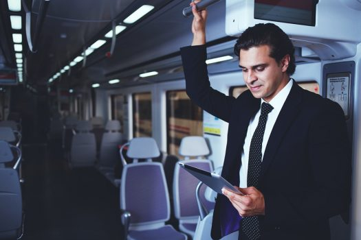 cpa with tablet working on train
